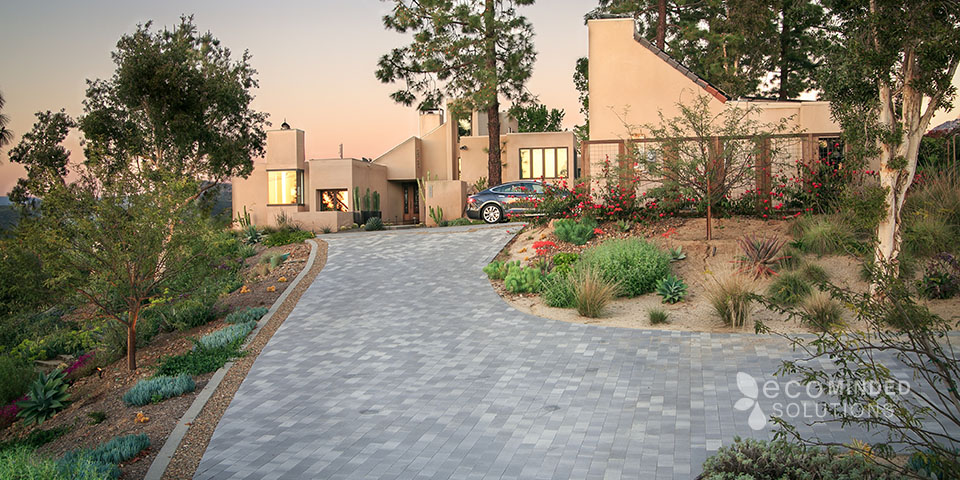 Grand driveway landscape leading to a sand colored desert home in Poway, CA